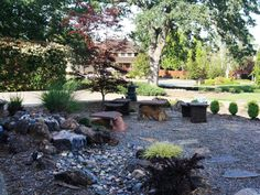 Stepping stones and a river rock water feature create a Zen-like atmosphere in this front yard Asian garden.