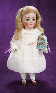 """Theriault's - 11"""" Large German All-Bisque Doll, Holding her Own Little All-Bisque Doll by Kestner, c 1910"""
