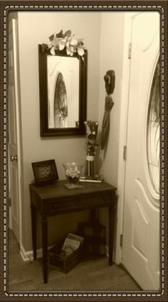 Take a quick glance at yourself in this mirror over an antique entry table and if it's raining, grab the umbrella hanging from the antique doorknob.  A cute little wooden crate underneath the table houses Ethan's Little Golden books and a monogrammed print  display with my favorite books pulls it all together.