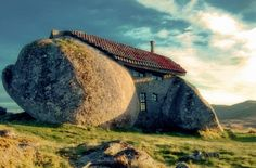 """The """"Casa da pedra"""" (House of Stone) built inside a rock in the mountains of Fafe in Portugal. Photo by Feliciano Guimarães"""