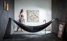 Floating hammock bathtub by SplinterWorks! Check out our luxurious master suite home plans at http://www.dongardner.com/Luxurious_Master_Suite.aspx. #MasterBath #HomePlan #SculpturalFurniture