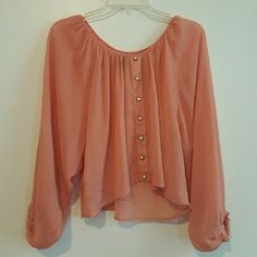 LONG SLEEVE PEACH BLOUSE Long bishop sleeve flowy blouse with cute buttons down the middle. In great condition, no imperfections. Bishop Sleeve, Long Blouse, Im Not Perfect, Middle, Peach, Ruffle Blouse, Blouses, Buttons, Long Sleeve