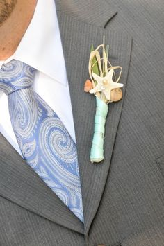 sweet beach #wedding idea for the groom's boutonniere