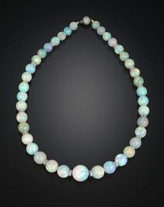 Graduated Opal Bead Necklace-Thirty-nine incredibly rare and large opal beads, weighing an amazing 386.00 total carats, comprise this outstanding necklace. The graduated gems are grand in size and perfectly matched, each exhibiting a mesmerizing level of translucence and color.