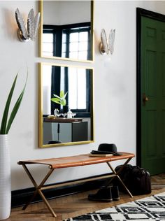 I love the idea of two stacked square mirrors!