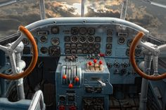 JU 52, from inside the cockpit of an older airplane and into the sky.
