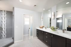 Check out this #modernbathroom we remodeled back in  2016! The huge floating vanity is a really nice touch and the dark gray tiles in the shower provide a nice splash of color!  www.remodelworks.com #remodelworks #sandiegoremodel #floatingvanity #bathroomremodel #designideas