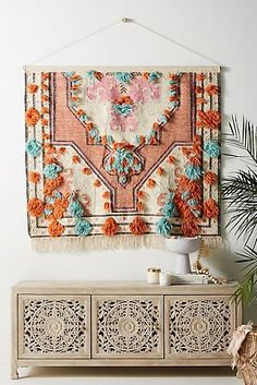 Milla Wall Hanging - Bold colours and tufted embellishments add a global feel to this handcrafted wall hanging. Diy Wand, Moroccan Decor Living Room, Living Room Decor, Bohemian Wall Decor, Hippie Living Room, Moroccan Wall Art, Moroccan Furniture, Ethnic Decor, Unique Wall Decor