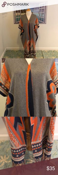 "On Trend Poncho/Duster Fab On Trend Long Poncho/Duster! EUC! Size: Small. Colors are blue, white, gray & like an orange but not a bright orange. Open front no closure. Has short sleeves. Cute tassels all around hem. Great paired with Denim & very soft material! Previously purchased in a boutique store in the Hamptons! 85% acrylic 15% cotton hand wash line dry or dry clean. Length approx 36"". Pls note too big for Mannequin but to demonstrate. NO TRADES. Peach Puff Sweaters Shrugs & Ponchos"