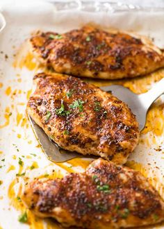 Made this and it's very good! I would even double the spice rub to cover more. Juicy Oven Baked Chicken Breast on a tray, fresh out of the oven