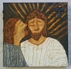 Judas betraying Jesus with a kiss.