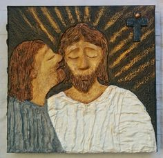 Judas betraying Jesus with a kiss.
