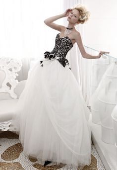 Illusion wedding dress with strapless sweetheart neckline and organza skirt. Features black appliqued bodice with flowers at the waist. Free made-to-measurement service for any size. Available colors seen as in Color Options.