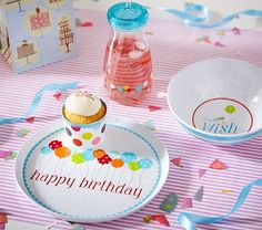 For a festive celebration, brightly decorated dishes and tumblers make a child's birthday even more special.