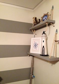 Nautical nursery love the rope shelves....I love this rope idea for any (nautical) room!!!