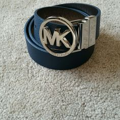Michael Kors Blue Belt Michael Kors Blue and Silver Belt. Silver MK Logo buckle. In gorgeous condition. Absolutely no defects or flaws of any kind. 5 different holes for adjustable sizing. 29 inches up to 33 inches length. Feel free to ask any questions. MAKE ME AN OFFER! FREE GIFT with every purchase! Bundle for further discounts. Michael Kors Accessories Belts