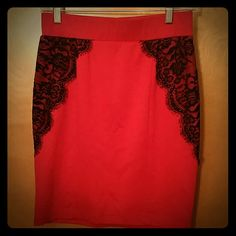 Red skirt Red spandex skirt with black lace on the sides. size medium I believe in junior sizes. fits a small/size 2-4 IN Skirts Pencil
