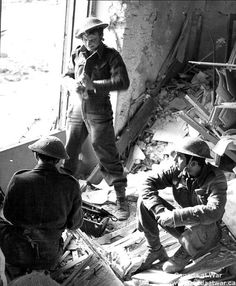 Ortona - Troops from The Loyal Edmonton Regiment shelter in a ravaged building while getting grenades ready for throwing.