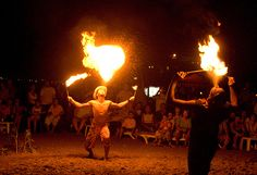 After a beautiful sunset, enjoy the fire twirling and juggling