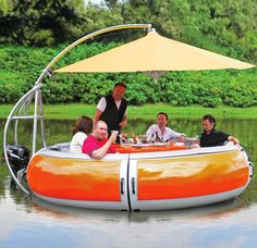 This might be the ultimate in summer entertaining... a barbecue dining boat. You can fire up the grill ON the lake!