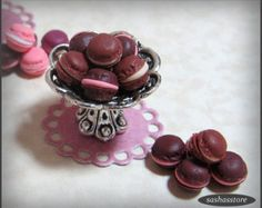 Miniature dollhouse 1:12 scale macaroons. Macaroons have been handmade using polymer clay. You will receive 12 loose macaroons which you can decorate to your liking. You will receive four different coloured macaroons, three of each colour (green, pink, brown and bordeaux). If you like the bowl that they are displayed in then you can check out the listing below to purchase the bowl seperately. https://www.etsy.com/listing/263548529/tiny-silver-bowl-miniature-home-decor?ref=shop_home_active_11