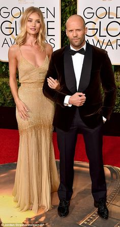 Loved-up! Jason walked home with his own Golden Globe in the form of the shimmering beauty...