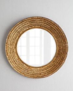"Mixed textures keep thing interesting as this dramatic mirror proves. It features a framed comprising myriad texture petals and an inner ""twisted rope border"""