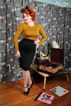 """Retro Pencil Skirt in Basic Black by Pinup Couture - Also in Plus Size  - No retro wardrobe is complete without this basic black pencil skirt   Made from a comfy cotton/spandex blend, it's as comfortable as it is cute! Features include: a sexy, curvehugging silhouette, a high waist with 2"""" yolk, and a provocative, 10"""" back slit. Available in both basic and plus sizes, to 2X. Matching Heidi Top and Jayne Top sold separately."""