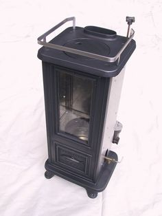 "Navigator's Mini Home Stove - it runs on diesel/bio diesel. 28"" tall and 12"" wide ... and it's got a fish on it.  Ok... so it's not a trout, but I think it'll still fit in the fishing cabin"