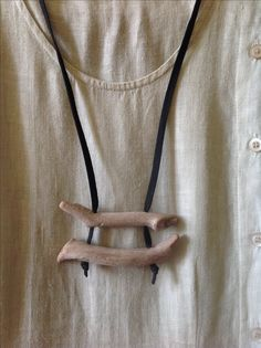 Only driftwood and leather. Made by:  Tes Jewelry on facebook.