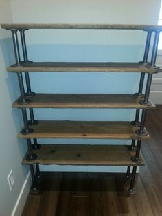 Shoe rack from barn wood and galvanized pipe.