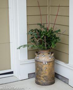 vintage milk jug becomes outdoor Christmas decor