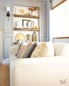 Fall Home Tour: Gold, gray and warm sand colored pillows with interesting patterns (from HomeGoods) will bring warmth into your fall decor. (#sponsored)