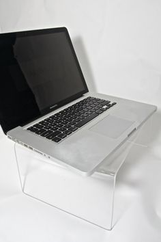 Made out of 1/4 acrylic, this stand is perfect for laptops to be used either on the lap or placed on a desk to keep the monitor at eye level to reduce strain.     Laptop stand surface area is 10 x 14 and is 5 tall.    Ported Cooling is 6 holes that are 3/8 diameter which allow the heat from the laptop to escape. If you DO NOT want your stand to include the holes, you must go to the Laptop Stand - Not Ported listing.    Laptop not included.
