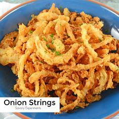 Strings Onion Strings are buttermilk soaked and lightly seasoned fried onions. Perfect for topping burgers, a snack or green bean casserole. Onion strings are also known as French fried onio… Onion Recipes, Vegetable Recipes, Savoury Dishes, Vegetable Dishes, Onion Strings, Catering, Blooming Onion, French Fried Onions, Crispy Onions