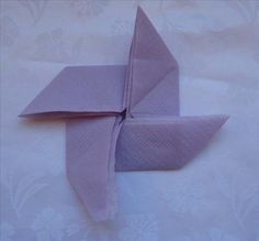 How to fold the pinwheel napkin fold