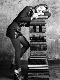 "Love the stack of books, but if that was me, id be happier, kind of silly looking like, ""Woah! what a stack of books!!"""