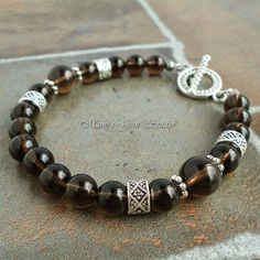 This handcrafted classy bracelet for men was made with Smoky Quartz gemstone well-polished high quality beads in a translucent, mystical grayish brown hue. I accentuated the bracelet with some detaile