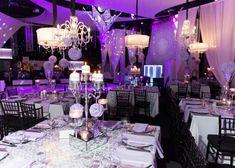 purple centerpieces and uplighting with crystal and mirrored details