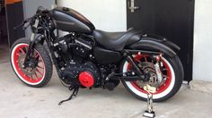 H-D 883 with red mags and whitewalls.