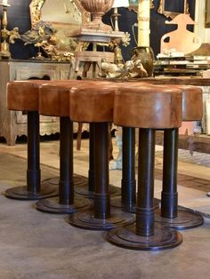 """These vintage French leather bar stools date to the 1950's. They were originally used in a pub and are a classic height. Eight available. 14¼"""" diameter x 32"""" high 36cm diameter x 81cm high"""