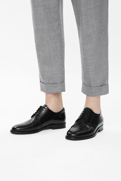 A classic style, these lace-up shoes are made from panels of smooth leather. With an asymmetric panel detail, they have leather insoles, anti-slip rubber inserts and neat topstitched edges.