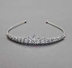 This crystal open leaf tiara will give any bride just the right amount of sparkle. Short in height, this gorgeous tiara provides the perfect mix of  stylish and the traditional. Style TH6643 #davidsbridal #tiara #weddings