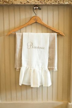 Cute towel holder...great idea and I even have a few wooden hangers - a vintage hanger eclecticallyvintage.com