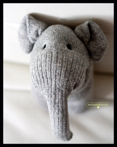 High quality gray wool baby elephant holding a flower (only one left)