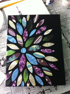 I'm going to need to make more of these for Christmas presents... Paint a canvas, cut images out in scrapbook paper, glue on, and Mod Podge over. So simple!