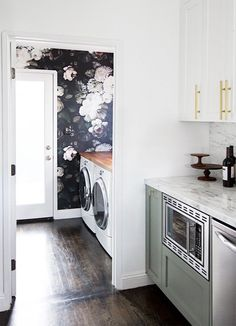 There's not a lot to the laundry room. A pair of machines. Maybe a countertop with a sink, if you're lucky. So an exciting laundry room decor idea is giving it all a beautiful backdrop with a bold wallpaper and make it your favorite room in the house. Image credit: Sarah Sherman Samuel