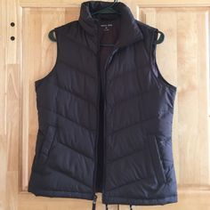 Land's End Down Vest Super warm and goes amazing with a pair of tan winter boots! Zippers up the middle with snap button pockets. Worn maybe 7 times-great condition. Fits like a small, dark brown. No trades please. Lands' End Jackets & Coats Vests