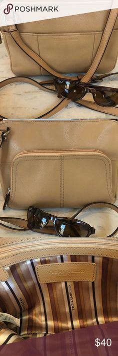 "Tignanello Crossbody Leather Bag Tignanello Leather Crossbody  Bag. Adjustable straps. Approximately 8"" height and 10"" width. One outside pocket with button. Another outside pocket with a lot of compartments inside and zipper closure. Two inside open pockets and one inside zipper pocket. Top zipper closure. Some gentle wear and tear but barely noticeable. Use this gorgeous leather Crossbody bag for Spring and Summer shopping and traveling🌷 Tignanello Bags Crossbody Bags"