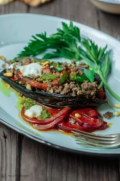 Mediterranean Stuffed Eggplant Recipe   The Mediterranean Dish. This is a must-try all star recipe for stuffed eggplants. Roasted eggplants stuffed with a fragrant spiced meat, bulgur and pine nut mixture. So good! See full recipe on TheMediterraneanDish.com